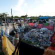 BALI, INDONESIA APRIL 11: Scavenging at the dump near the gianyar town on April 11, 2012 on Bali, Indonesia. Bali daily produced 10,000 cubic meters of waste. - Stock Photo