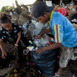 Стоковое фото: BALI, INDONESI APRIL 11: Poor from Javisland working in scavenging at dump on April 11, 2012 on Bali, Indonesia. Bali daily produced 10,000 cubic meters of waste.