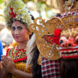 BALI, INDONESIA  APRIL 9: Young girl during a classic national Balinese dance formal wear on April 9, 2012 on Bali, Indonesia. formal wear is very popular cultural show on Bali. — Stock Photo