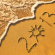 Stock Photo: 2013 written in sand on beach texture, soft wave of the sea.