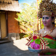 BALI, INDONESIA  APRIL 9: Balinese girl posing for hiker before a classic national Balinese dance formal wear on April 9, 2012 on Bali, Indonesia. formal wear is very popular cultural show on Bali. — Stock Photo