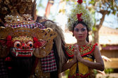 BALI, INDONESIA - APRIL 9: Balinese girl posing for turists before a classic national Balinese dance Barong on April 9, 2012 on Bali, Indonesia. — Stock Photo