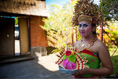 BALI, INDONESIA APRIL 9: Balinese girl posing for hiker before a classic national Balinese dance formal wear on April 9, 2012 on Bali, Indonesia. formal wear is very popular cultural show on Bali. — Stok fotoğraf