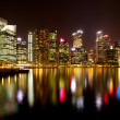 A view of Singapore business district in the night time with water reflections.  — Stock Photo