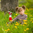 Lovely emotional five-year girl sitting in grass — Stock Photo