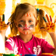 Beautiful little girl artist with paint of face — Stock Photo #19725091