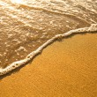 Beach sand texture. Soft wave of the sea. — Stock Photo