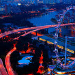 Royalty-Free Stock Photo: Aerial view on Singapore Flyer from roof Marina Bay Sands at night.