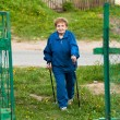 Stock Photo: Active old womnordic walking outdoors, 85 years old.