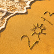 2013 written in sand on beach texture - soft wave of the sea. — 图库照片