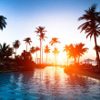 Beautiful sunset at a beach resort in the tropics — Stock Photo
