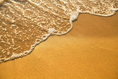 Soft wave of the sea and beach sand texture — Stock Photo