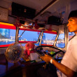 BANGKOK - APRIL 30: Unidentified driver of a water bus plying the Chao Phraya River, Apr 30, 2012 on Bangkok. — Stockfoto