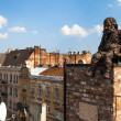 LVIV, UKRAINE - AUG 6: Chimneysweep monument is on the roof of a historic building House of Legends on Aug 6, 2012 in Lviv, Ukraine - Stok fotoraf