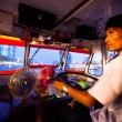 Stock Photo: BANGKOK - APRIL 30: Unidentified driver of water bus plying Chao PhrayRiver, Apr 30, 2012 on Bangkok