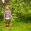 Little girl posing with the Russian Samovar on park - Stock Photo