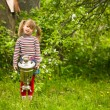 Little girl posing with the Russian Samovar on park — Stock Photo