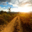 Road and mountain landscape at sunset in northern Thailand — Stock Photo