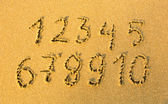 Numbers one to ten written on a sandy beach. — Stock Photo