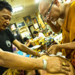 Stock Photo: Unidentified monk makes Yantrtattooing