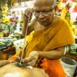 Unidentified monk makes Yantra tattooing — Stockfoto