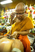 Unidentified monk makes Yantra tattooing — Stock Photo