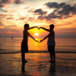 Couple holding hands heart-shaped — Stock Photo