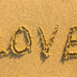 Stock Photo: The word LOVE on sand