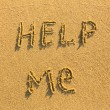 Royalty-Free Stock Photo: Help me - Inscription on the sand