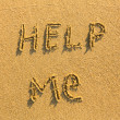 Help me - Inscription on the sand - Stock Photo
