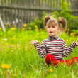 Funny lovely little five-year girl in park — Stock Photo #23061220