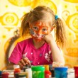 Little child, drawing paint with paint of face — Stock Photo #23061222