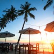 Sunset at a beach resort in the tropics — Stock Photo