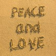 Peace and Love - drawn on the sand  — Stock Photo