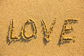 The word LOVE on sand — Stock Photo
