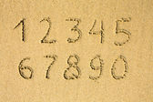 Numbers written on a sandy beach — Stock Photo