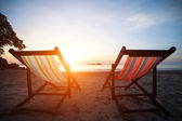 Loungers on the deserted coast sea — Stock Photo