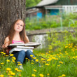 Teen-girl in the park with books — Stock Photo