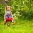 Funny lovely little five-year girl in park — Stock fotografie