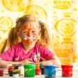 Stock Photo: Little child, drawing paint with paint of face