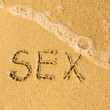 Sex written on sand — Stock fotografie