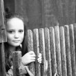 Teen-girl standing near vintage rural fence, black-and-white photo. — Stock Photo #23091850