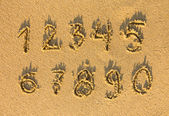 Numbers written on a sand — Stock Photo