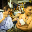 Unidentified monk makes traditional Yantra tattooing during Wai Kroo Master Day Ceremony in Wat Bang Pra in Nakhon Chai, Thailand. — Stockfoto