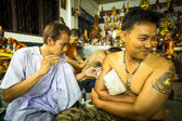 Unidentified monk makes traditional Yantra tattooing during Wai Kroo Master Day Ceremony in Wat Bang Pra in Nakhon Chai, Thailand. — Stock Photo