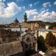 LVIV, UKRAINE - AUG 6: City view from roof historic building House of Legends on Aug 6, 2012 in Lviv, Ukraine. On 2009 Ukrainian magazine Focus judged Lviv best Ukrainian city to live. — Stok fotoğraf
