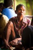 BERDUT, MALAYSIA - APR 8: Unidentified woman Orang Asli thresh rice to remove chaff on Apr 8, 2013 in Berdut, Malaysia. — Stock Photo