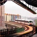 KUALA LUMPUR, MALAYSIA - MAR 30: Monorail train on Mar 30, 2013 in Kuala Lumpur, Malaysia. KL Monorail opened on 31 August 2003, and serves 11 stations running 8.6 km. — Stock Photo #24688665