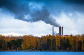 Air pollution by smoke coming out of factory chimneys — Stock Photo