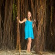 Teen-girl in a blue dress in mangrove forest (Wonderland concept) — Stock Photo #24704709